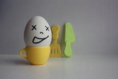 Uova con il fronte Concetto della prima colazione precoce Immagine Stock
