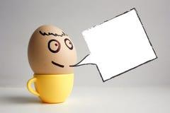 Uova con il fronte dipinto Concetto fotografia stock libera da diritti