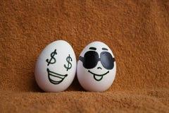 Uova con la foto dei fronti per la vostra progettazione Fotografie Stock