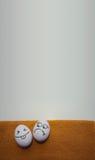 Uova con la foto dei fronti per la vostra progettazione Fotografie Stock Libere da Diritti
