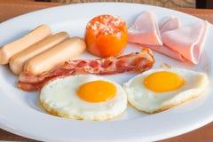 Uova della prima colazione con il prosciutto fotografia stock