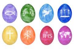 Uova di Pasqua Con i simboli cristiani Fotografia Stock