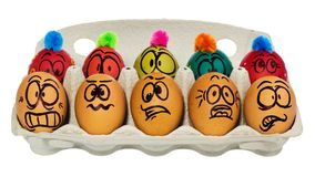 Uova di Pasqua, dipinte a mano con sorridere e il fac terrorizzato del fumetto Fotografie Stock