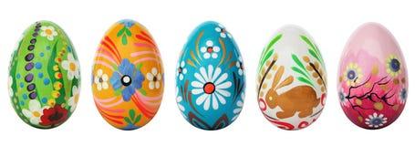 Uova di Pasqua dipinte a mano isolate su bianco Modelli della primavera Immagine Stock