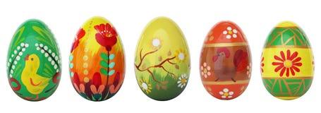 Uova di Pasqua dipinte a mano isolate su bianco Modelli della primavera Fotografia Stock