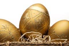 Uova di Pasqua dorate Immagini Stock