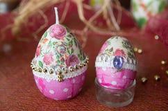 Uova di Pasqua e candele Immagine Stock