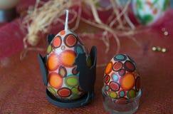 Uova di Pasqua e candele Fotografia Stock Libera da Diritti