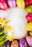 Uova di Pasqua e carta Fotografie Stock