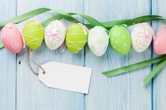 Uova di Pasqua ed etichetta in bianco dell'etichetta Fotografie Stock Libere da Diritti