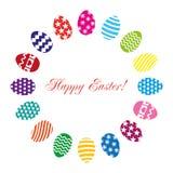 Uova di Pasqua messe su un fondo bianco Fotografia Stock Libera da Diritti