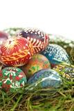 Uova di Pasqua in primo piano del nido Fotografie Stock
