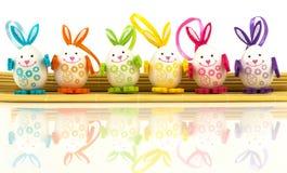 Uova di Pasqua sulla stuoia Fotografie Stock