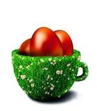 Uova di Pasqua in tazza dell'erba illustrazione vettoriale