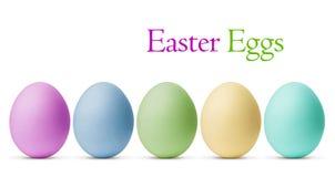 Uova di Pasqua variopinte isolate su fondo bianco Fotografia Stock Libera da Diritti