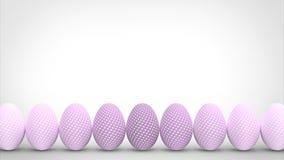 Uova di Pasqua Variopinte isolate su priorità bassa bianca Immagini Stock