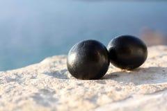Uova di pietra nere Fotografia Stock