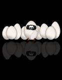 Uova divertenti su priorità bassa nera Fotografia Stock Libera da Diritti