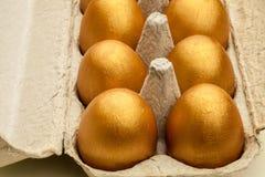 Uova dorate Immagini Stock