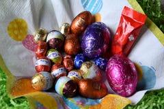 Uova e coniglietti di cioccolato dalle fabbriche del cioccolato Immagine Stock Libera da Diritti
