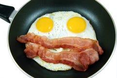 Uova e pancetta affumicata Fotografie Stock