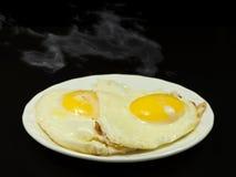 Uova fritte calde. Fotografie Stock