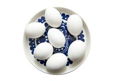 Uova isolate sui precedenti bianchi Immagine Stock Libera da Diritti