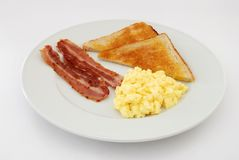 Uova rimescolate con pancetta affumicata Fotografie Stock