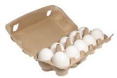 Uova su un fondo bianco Fotografia Stock