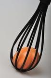 Uovo all'interno del battitore Fotografia Stock Libera da Diritti