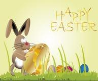Uovo del fondo di Pasqua in oro ed in coniglietto Immagini Stock Libere da Diritti