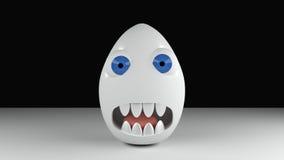 Uovo del mostro con gli occhi azzurri ed i denti Fotografia Stock