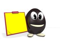 Uovo di cioccolato e memotac giallo Fotografie Stock Libere da Diritti