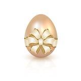 Uovo di Pasqua con l'arco Fotografia Stock Libera da Diritti