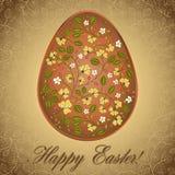 Uovo di Pasqua con l'uva spina, cartolina d'auguri marrone dell'oro Fotografia Stock