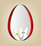 Uovo di Pasqua con le siluette dei coniglietti Fotografia Stock