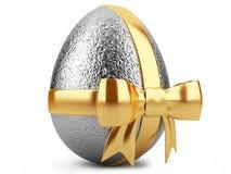 Uovo di Pasqua d'argento con il nastro dell'oro Immagine Stock Libera da Diritti