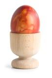 Uovo di Pasqua In portauovo Immagini Stock