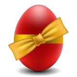 Uovo di Pasqua Rosso con l'arco giallo illustrazione di stock