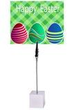 Uovo di Pasqua Sul supporto dell'appunto del Libro Verde Immagine Stock Libera da Diritti