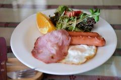 Uovo fritto, bacon ed arancia fresca Immagine Stock Libera da Diritti