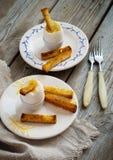 Uovo sodo e pane tostato per la prima colazione Fotografie Stock Libere da Diritti