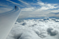 Up above the clouds. Flying high above the clouds in a glider. Wave lift passes through the clouds and carries you higher Royalty Free Stock Photos