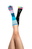 Up In The Air Feet in differnet socks with toes. Two legs in different and colorful happy socks. The toes are colorful with smileys and hearts. Above they are Royalty Free Stock Image