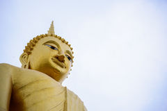 Up angle view of Golden buddha statue with sky. Up angle view of Golden buddha statue with sky background Royalty Free Stock Photos