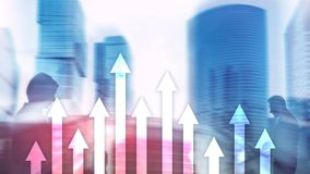 Up arrow graph on skyscraper background. Invesment and financial growth concept. royalty free stock photography
