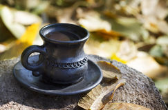 Сup in the autumn garden. Coffee cup in the autumn garden Royalty Free Stock Photography