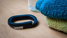 UP band. LONDON, UK - 24 MAY 2014: Photo of a black fitness UP band by Jawbone lying on a table, photographed on 24th May 2014 Royalty Free Stock Photos
