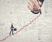 Up the career ladder. Businesswoman climbing up staircase as symbol of career rise Royalty Free Stock Image