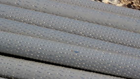 An up-close image of  steel pipes piled stock video